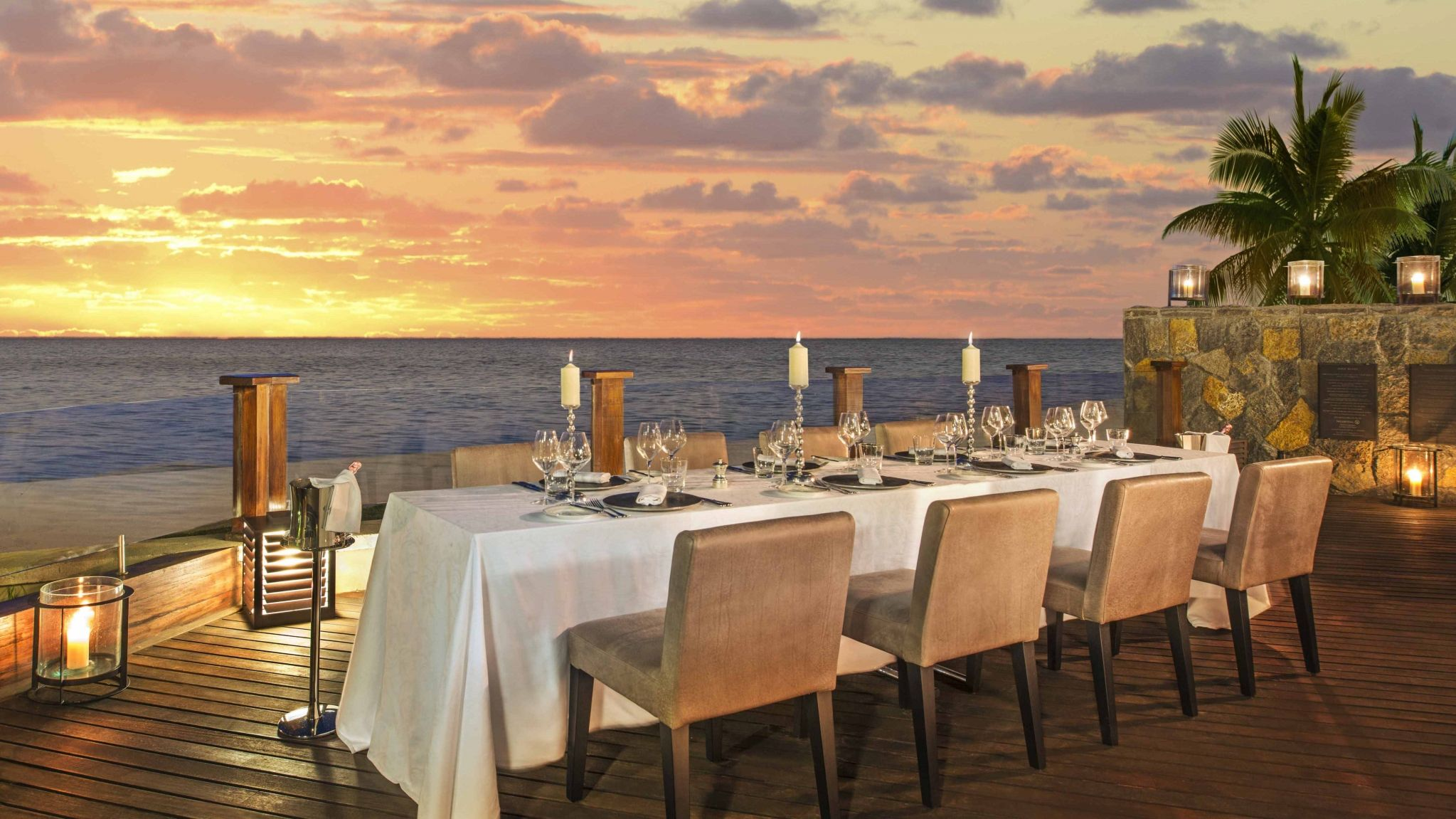 The St. Regis Mauritius Resort Dining with sun set over ocean